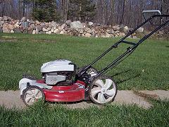gas push mower by Gary & Anna Sattler